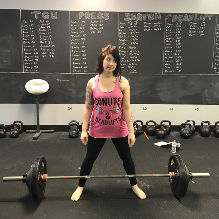 woman exercises in a crossfit gym in birmingham, alabama