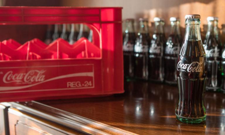 glass coca cola bottles on a countertop