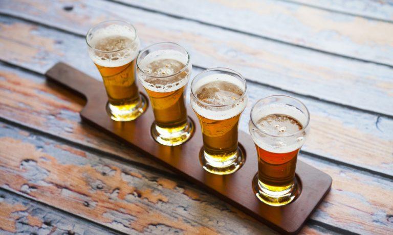 flight of different beer varieties