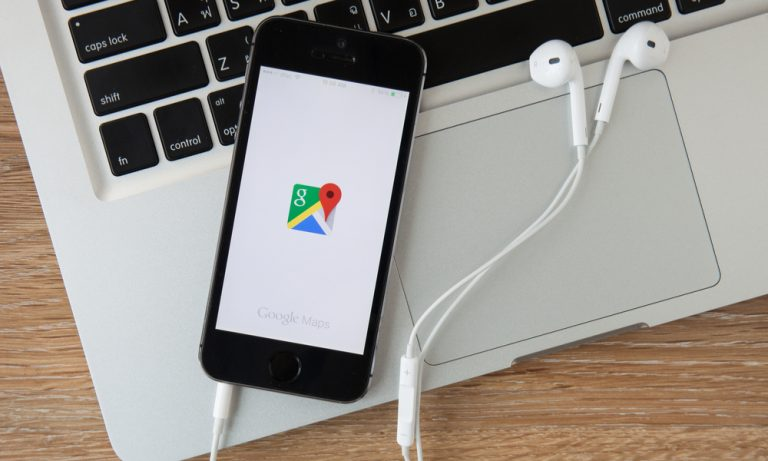 a cell phone with google maps app open on it