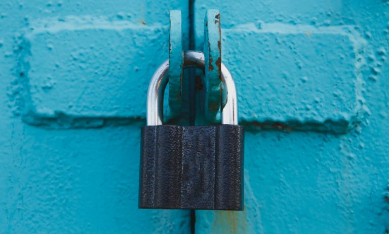 padlock locking a blue metal door