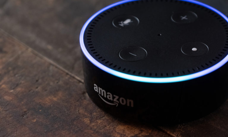 Amazon Echo Dot on a wooden table