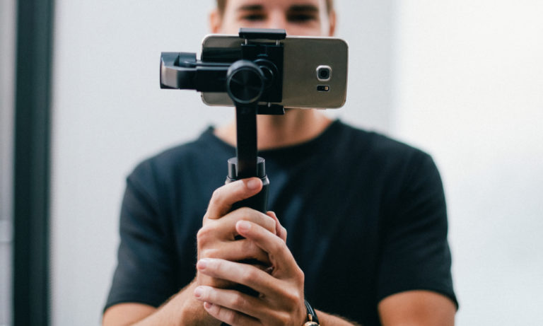 man filming with phone in a gimbel