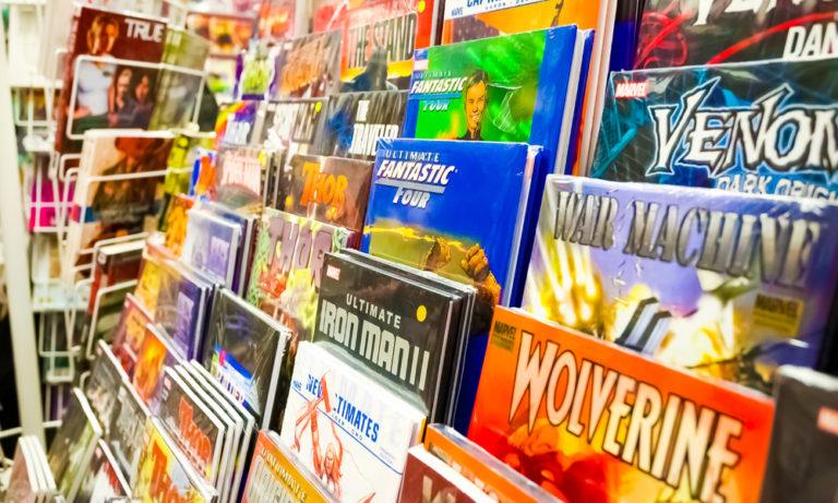 superhero comic books displayed in a store