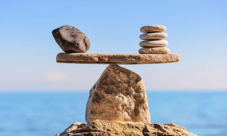 different rocks balance on other rocks to form a scale