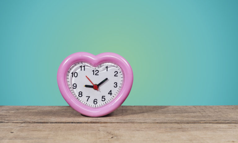 heart shaped clock on a wooden table
