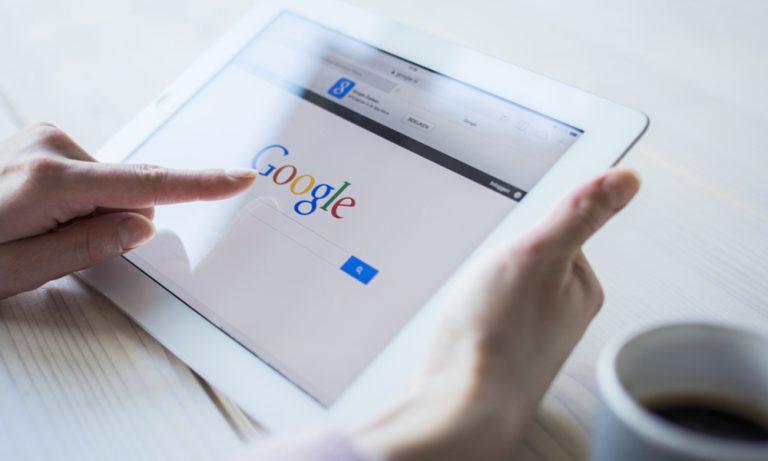 woman using google on an ipad
